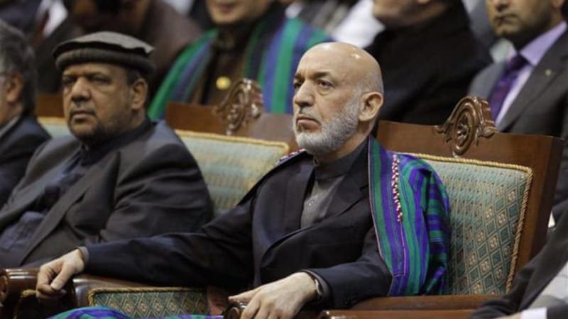 Karzai said he would not sign a security deal until new requirements had been met [Reuters]