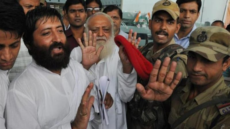 Asaram (C), and his son Narayan Sai (L) had a big following in northern states before the scandal broke [EPA]