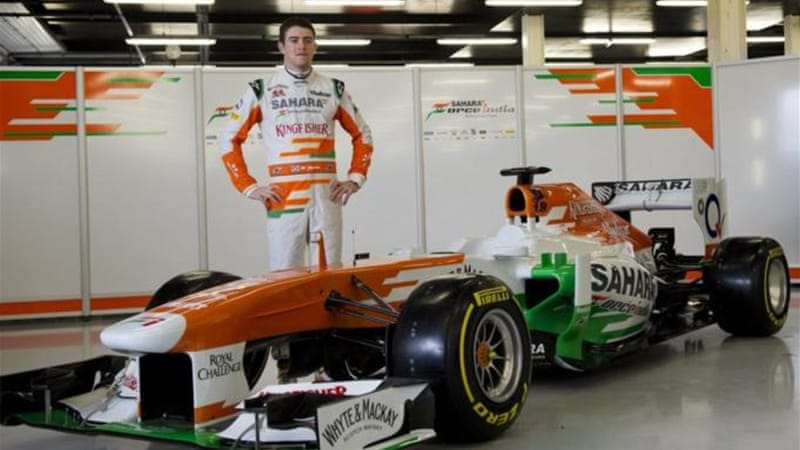 Me, myself and car: Force India's only driver Paul Di Resta poses with the VJM06 at Silverstone [AFP]