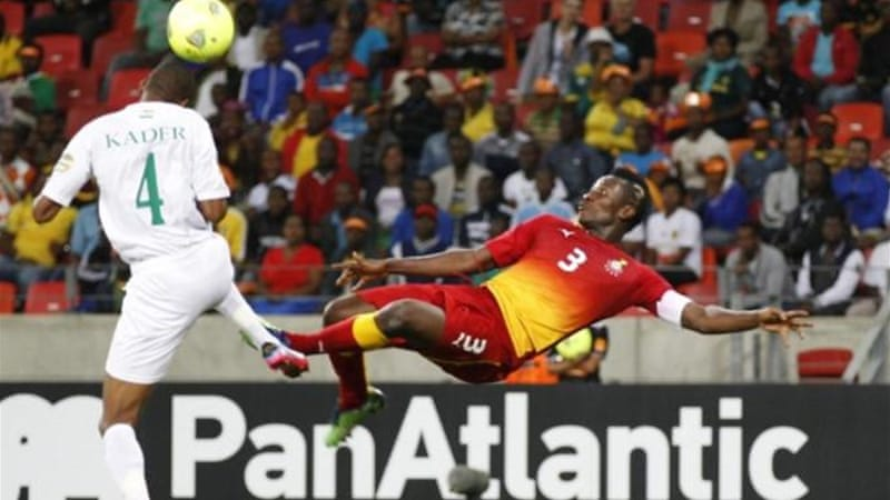 In a team of debutantes, bicycle kicking Gyan (R) is Ghana's most experienced and talented forward [Reuters]