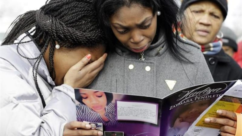 Family and friends of Hadiya Pendleton, along with Michelle Obama, attended the teenager's funeral in Chicago [AP]