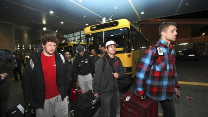 Shared passion: U.S. freestyle wrestling team arrive at Imam Khomeini airport in Tehran, Iran, [AP]