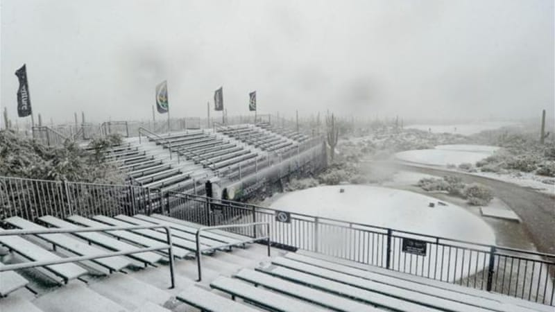 Snow go area: The white stuff covers the first hole tee and the grandstand in Arizona [GALLO/GETTY]