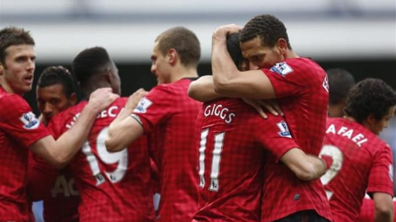 It is hugs all around in the United camp with Rio Ferdinand congratulating goalscorer Ryan Giggs [AP]