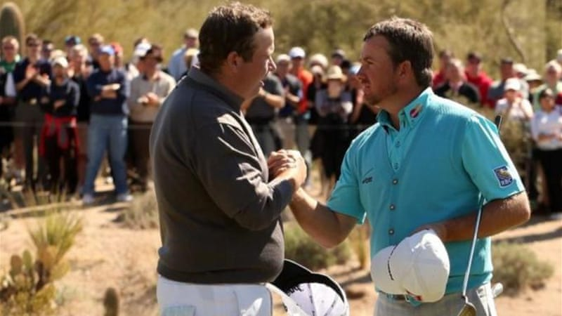 Defeated Shane Lowry (L) congratulates countryman Graeme McDowell in Arizona [GALLO/GETTY]