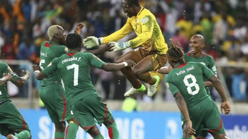 Goalkeeper Daouda Diakite (C) celebrates with teammates after historic and heroic victory [EPA]