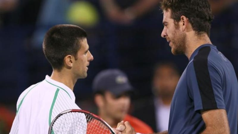 Three-time Aussie Open winner Novak Djokovic (L) shakes hands with opponent Del Potro following match [AFP]
