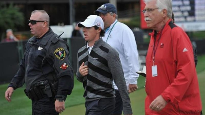 Bad start to season continues as defending champion Rory McIlroy walks off during 18th hole [GETTY]