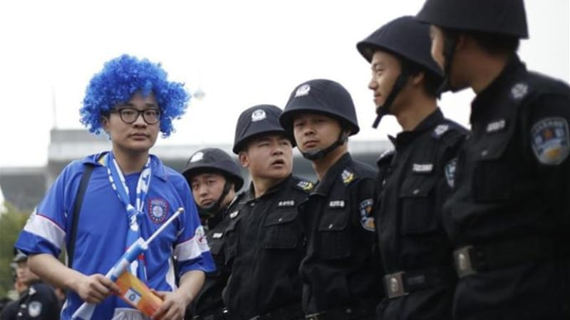 Thousands of police officers ensured Chinese and Japanese supporters did not clash [AFP]