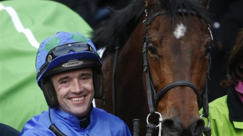Ruby Walsh and Hurricane Fly were big winners on opening day of the Cheltenham Festival [Reuters]