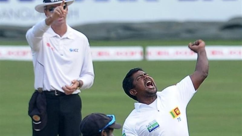 Sri Lankan bowler Rangana Herath (R) has eased into the space left by legend Muralitharan [AFP]