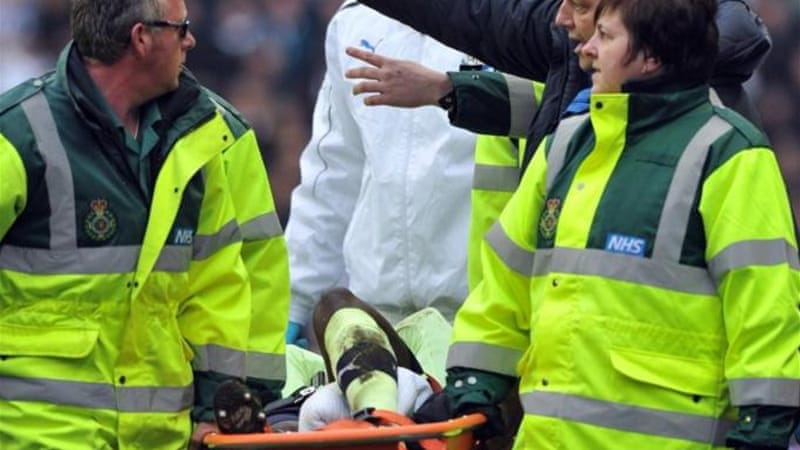 United defender Massadio Haidara is stretchered off after being tackled by Callum McManaman [AFP]