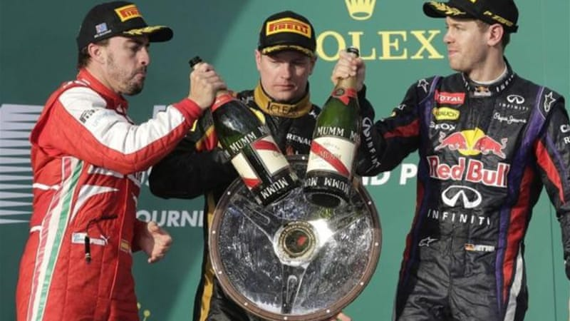 Raikkonen (C) celebrates with Fernando Alonso (L) and Sebastian Vettel after winning opening Aussie GP [AP]