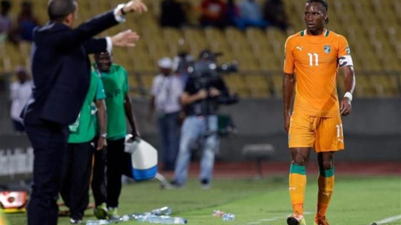 Ivory Coast coach Sabri Lamouchi (L) is setting more instructions for star Ivorian Didier Drogba [AP]
