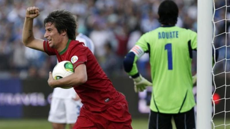 Fabio Coentrao scores with only seconds left to preserve Portugal's chances of qualifying [AP]