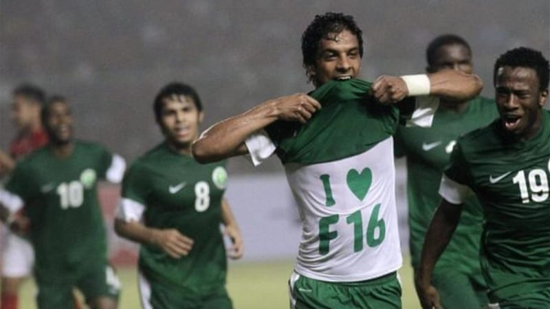 Saudi Al-Salem (2nd R) celebrates after scoring against Indonesia and their 75,000 home supporters [Reuters]