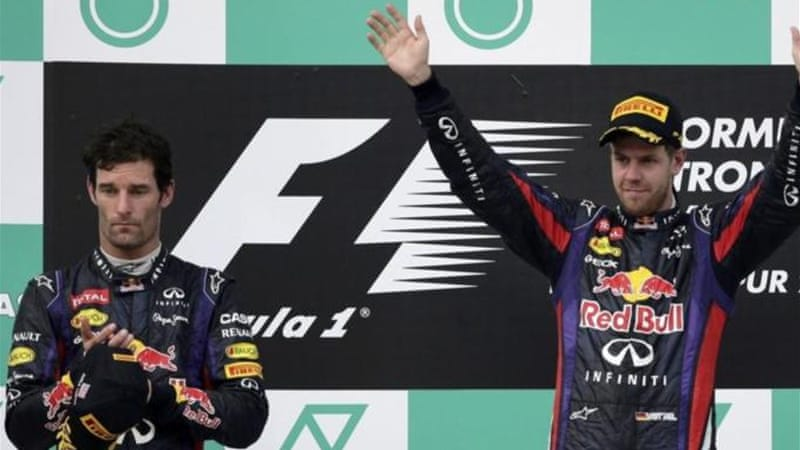 Mark Webber (L) will show up in China says his father despite a breakdown with Vettel (R) [Reuters]