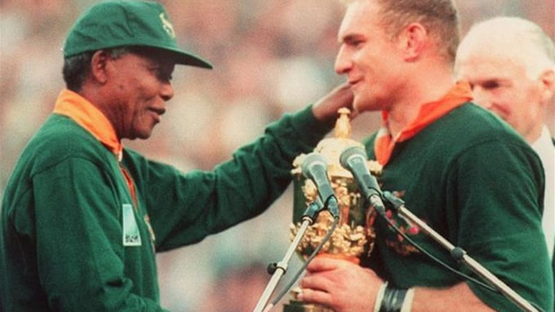 Part of history: Mandela congratulates South African captain Francois Pienaar after winning 1995 World Cup [AFP]