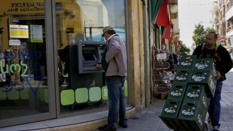 Capital controls stifle Cyprus as banks open