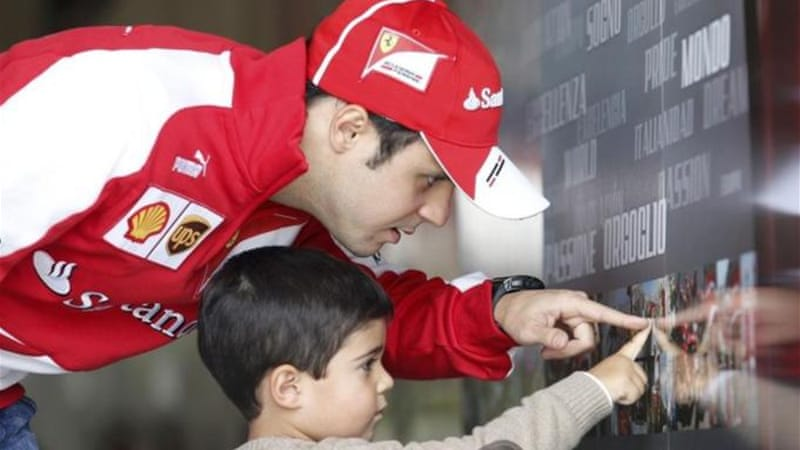 Massa and son Felipinho after his blistering day around the Shanghai International Circuit [Reuters]
