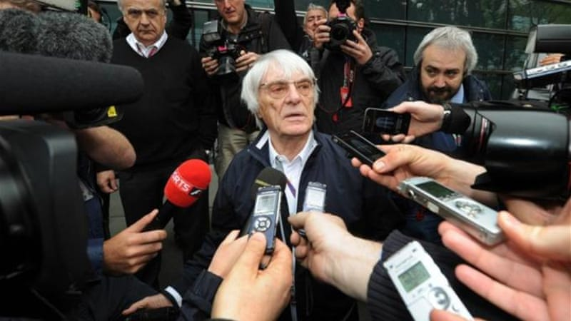 F1 supremo Ecclestone (C) has plenty of questions to answer when it comes to Bahrain [AFP]