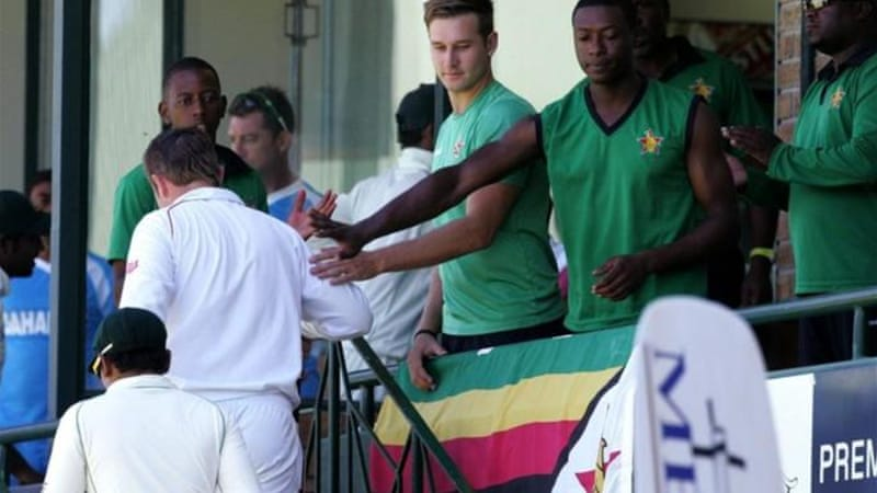 Zimbabwe captain Taylor is greeted by teammates after becoming top scoring Test skipper [AFP]