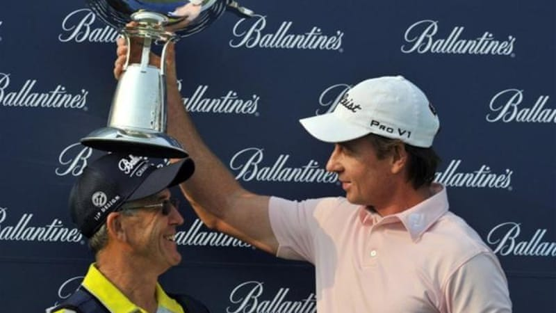 Rumford (R) praised his caddy Ronnie (L) and his coach Pete Cowan after playoff victory [AFP]