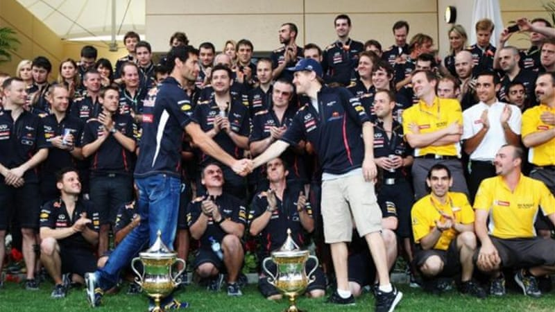 Sebastian Vettel (R) celebrates 2012 Bahrain GP victory with Red Bull teammates in Sakhir [GALLO/GETTY]