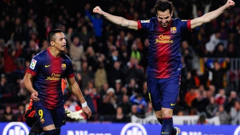 Cesc Fabregas (R) scored his first hat-trick for Barcelona as they thrashed Mallorca [GETTY]