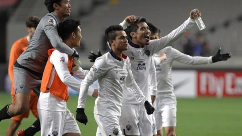 Buriram players celebrate advancing to round 16 of AFC Champions League on goal difference [GALLO/GETTY].