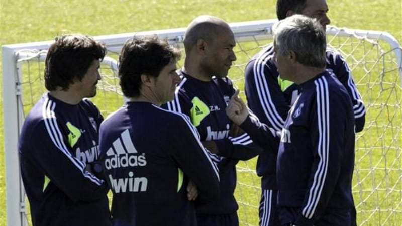 Mourinho (R) is spending his time talking to his assistants instead of the press [EPA]
