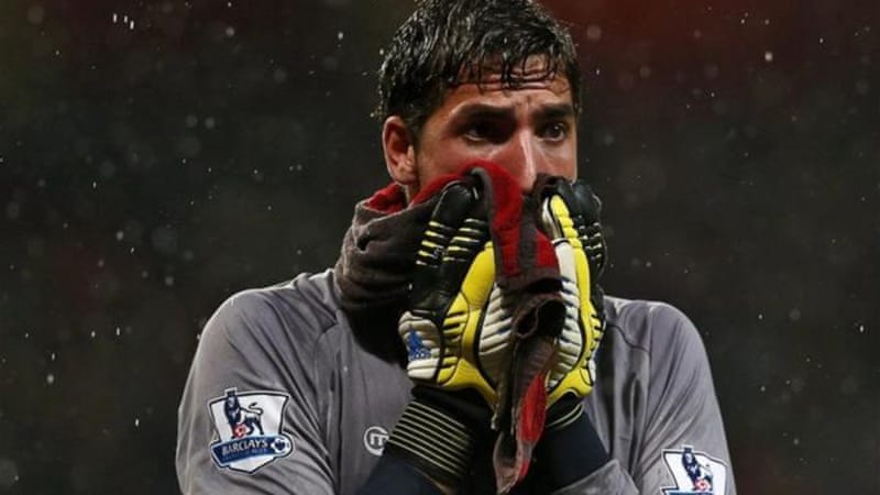 The face of relegation: Wigan keeper Joel Robles is dejected after conceding four goals and Premier League status [EPA]