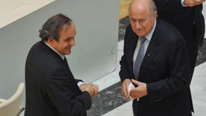 FIFA President Joseph Blatter (R) has shown support for UEFA President Michel Platini to replace him [AP]