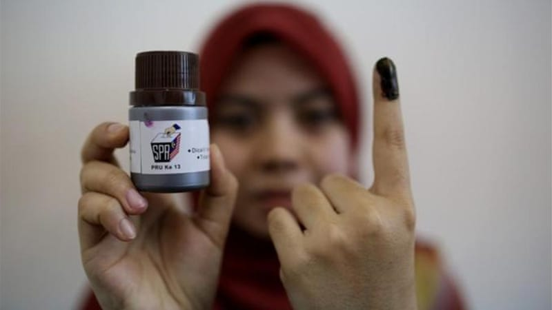 Reform groups are concerned over reports that ink used to mark voters can be washed off [AFP/Getty Images]