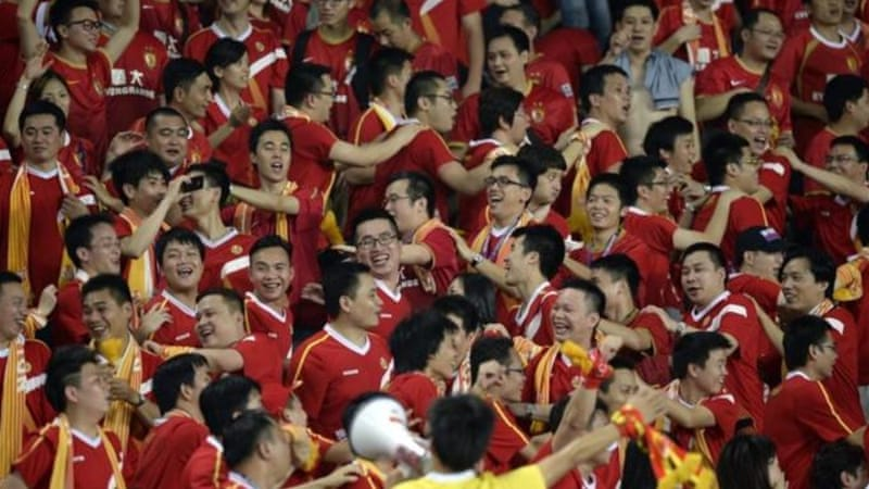 Evergrande's fans celebrate after a convincing 5-0 aggregate victory over Central Coast Mariners [AFP]