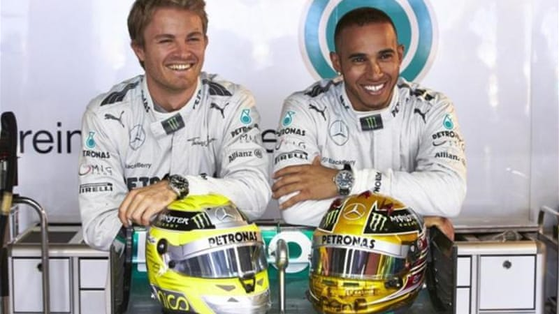 The Merc boys: Hamilton (R) played second fiddle to Nico Rosberg (L) at the Monaco Grand Prix [AP]