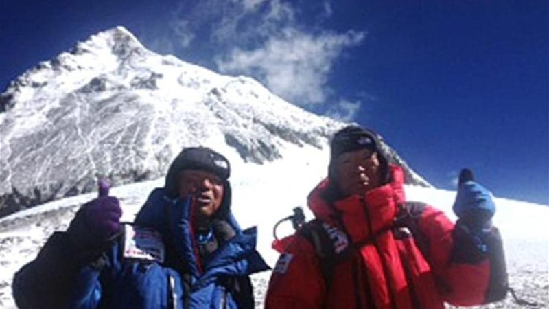 Yuichiro (R) and son Gota pose during their successful expedition climb up Mount Everest [AP]