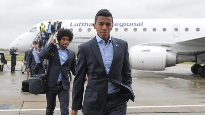 Dante (L) and Luiz Gustavo (foreground) are on their way to Brazil rather than to the German Cup final [EPA]