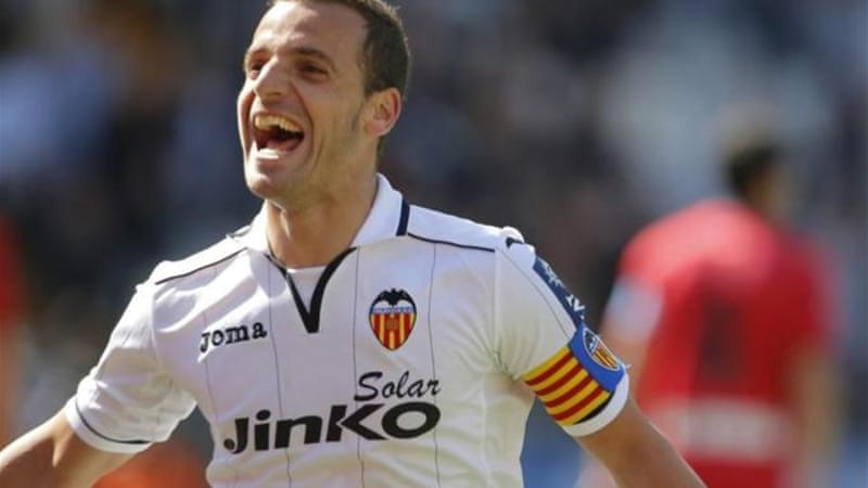 Valencia's striker Roberto Soldado celebrates opener against Osasuna [AFP]