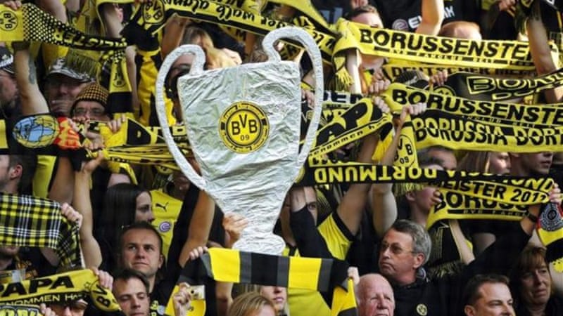 Borussia Dortmund fans have already got hands on the cup but their team has to wait until May 25 [EPA]