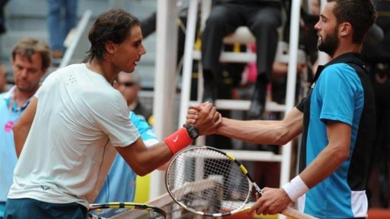 Nadal (L) is not getting ahead of himself following his opening 6-3, 6-4 victory over Benoit Paire [AFP]