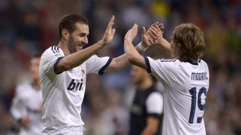 Karim Benzema (L) and Luka Modric (R) were both of the scoresheet as Real hit six past Malaga [AFP]