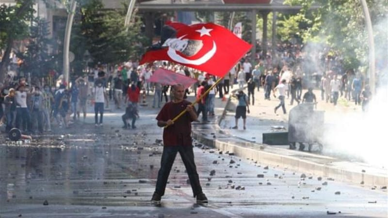 Turkish police forces pulled out of Taksim Square on Saturday after a second day of violent confrontation [AFP]