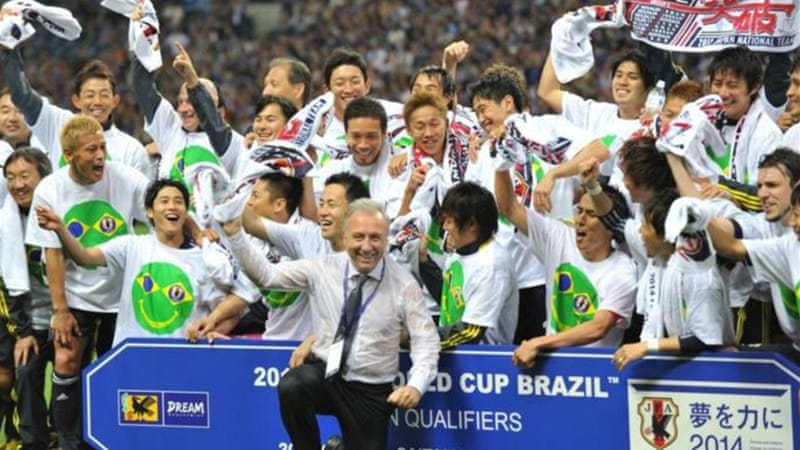 Japan coach Alberto Zaccheroni (C, front) and players celebrate early qualification for the 2014 World Cup [AFP]