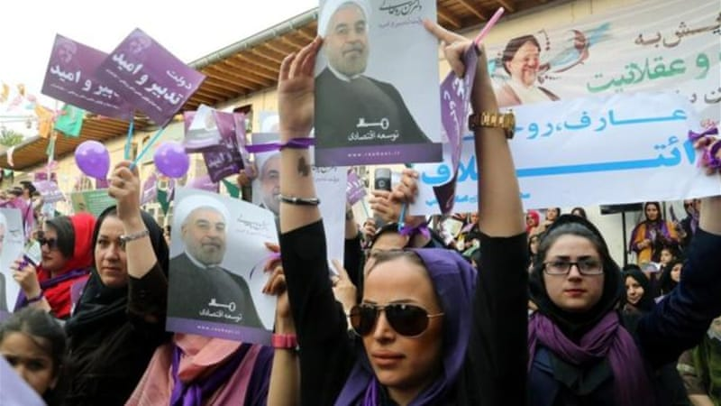 Reformist politicians and their supporters are throwing their weight behind Hassan Rouhani [AFP]