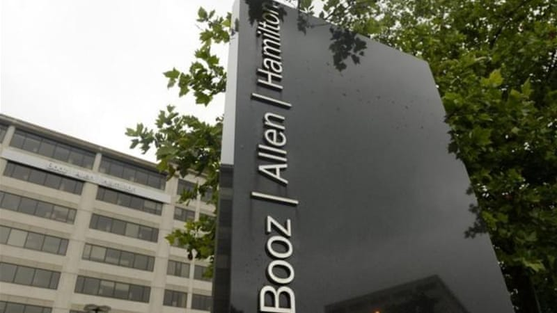 Employees of private contractor Booz Allen Hamilton routinely pass in and out of government [EPA]