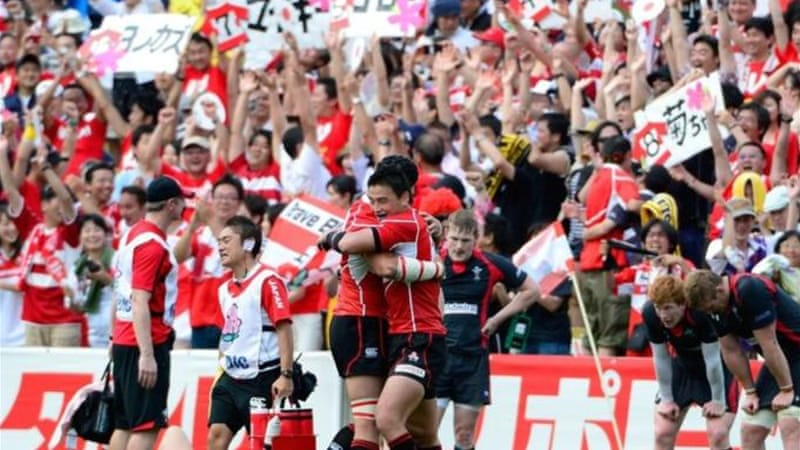 Blossoming: Japan celebrate first ever victory over a major rugby nation in nearly 80 years of competition [AFP]