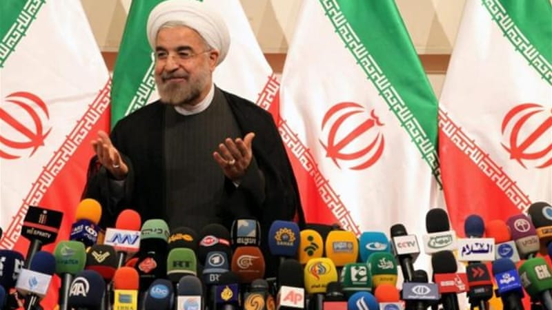 Hassan Rouhani gave his first press conference on Monday since winning presidential elections over the weekend [EPA]