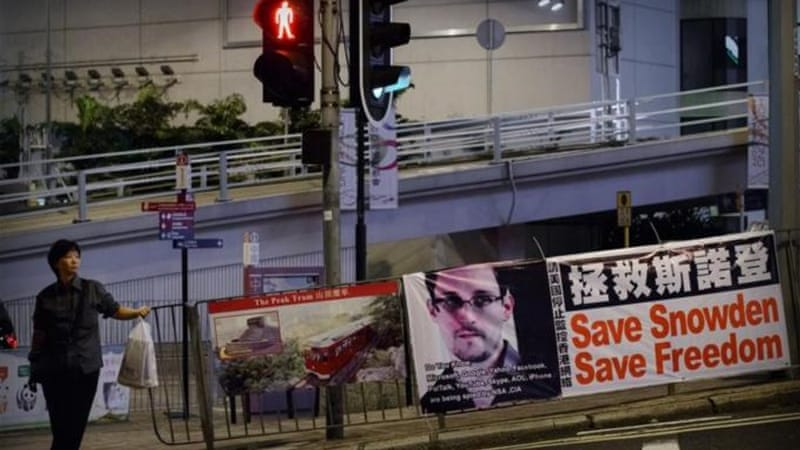 Snowden, who has been called a hero and traitor, is believed to be hiding in Hong Kong [AFP]