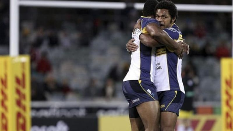 Scorer Tevita Kuridrani (R) and Henry Speight of Brumbies celebrate only try of the match [GALLO/GETTY]